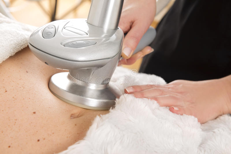 Slimming and cellulite treatment at clinic stock images
