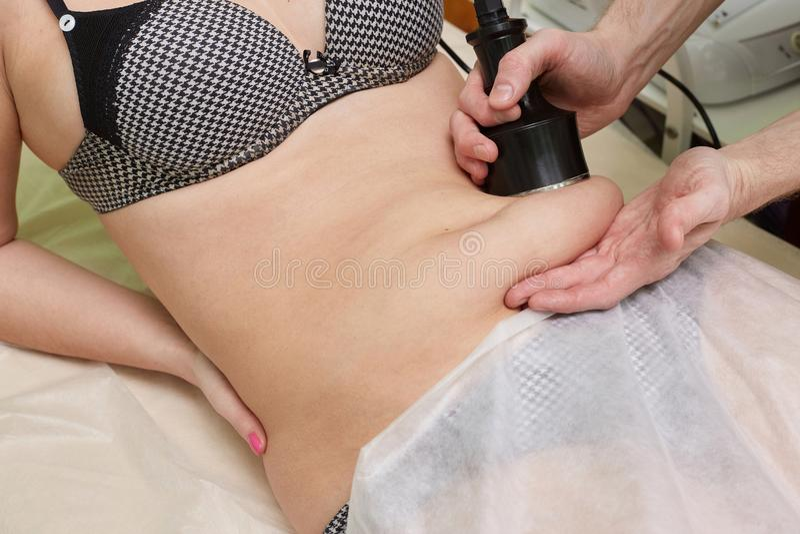 Slimming procedure of vacuum massage in cosmetic cabinet stock photos