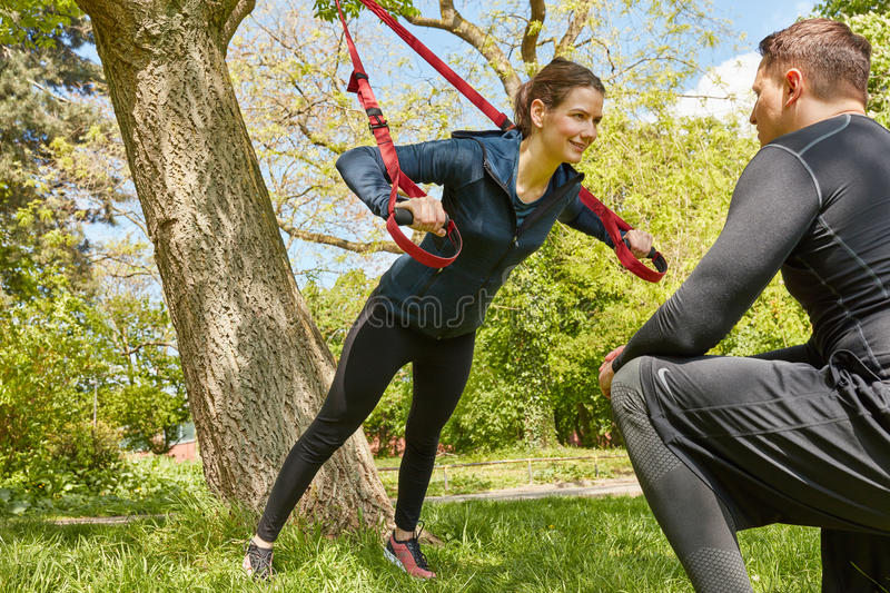 Sling training with Personal Trainer stock image