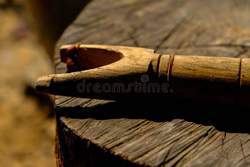 A slingshot on a log stock photo