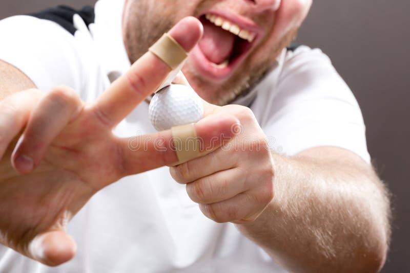 Slingshot making on mans fingers stock images