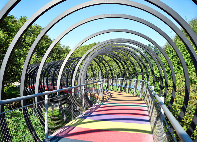 Slinky Springs Bridge. Modern bridge with multicolored gangway royalty free stock photo