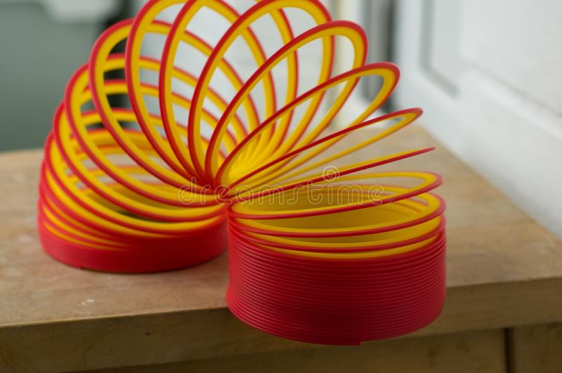 Slinky toy. Plastic colorful toys stock images