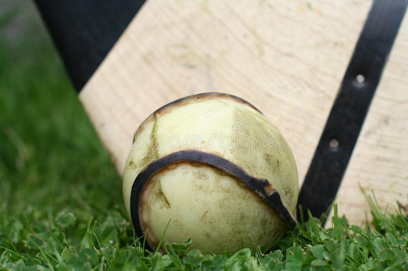 Irish Sliotar with hurl in the background royalty free stock images