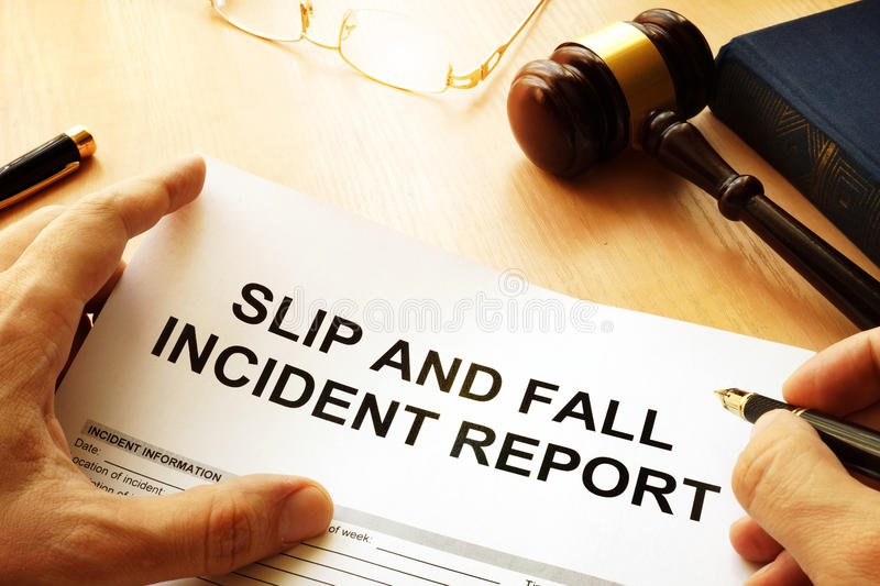 Slip and fall injury report. Slip and fall injury report on a table stock photo