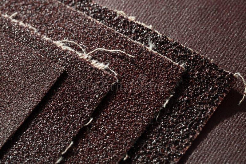 Uppsättningen av sandpapperet täcker arkivfoto