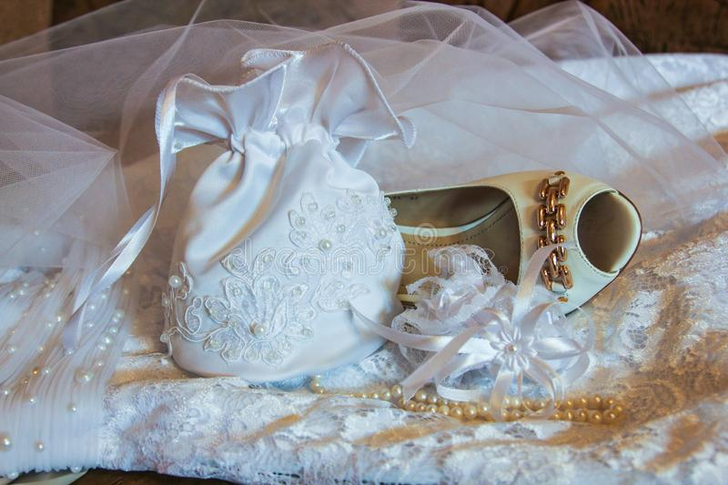 Slipper, handbag and beads of the bride in Kazan, Russia stock photography