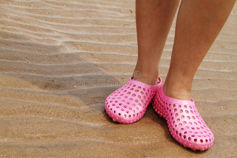 Slippers on the beach royalty free stock photos