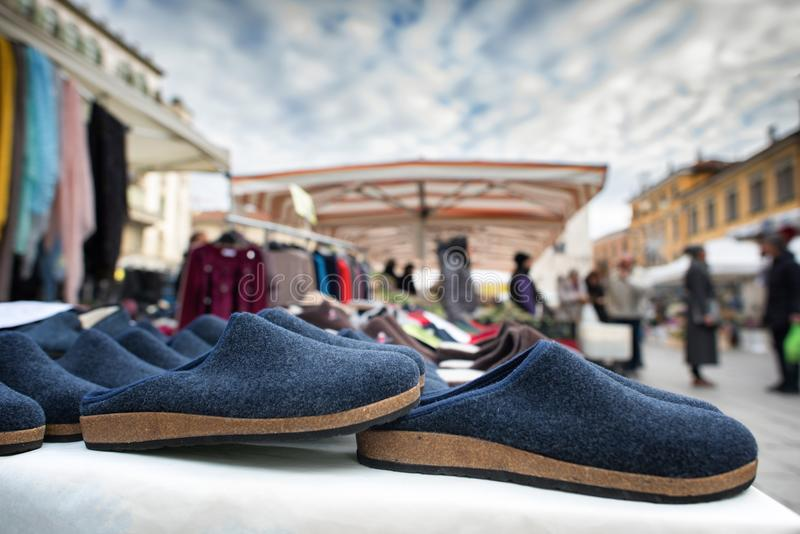 Slippers on sale at an open air Italian market royalty free stock photography