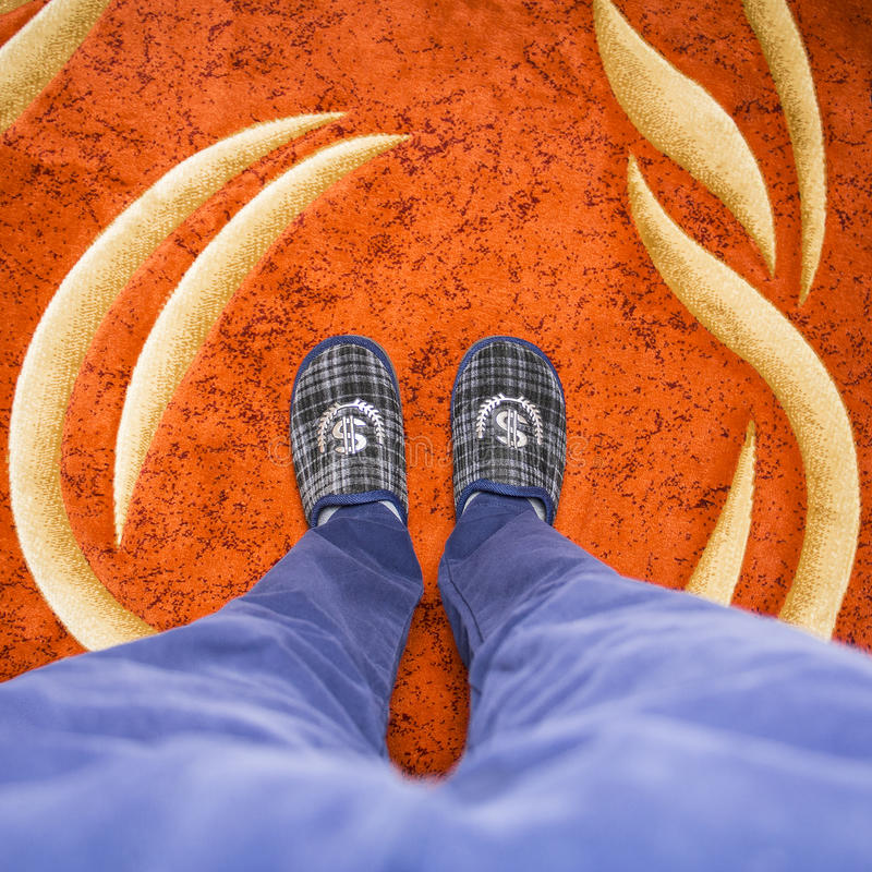 Slippers are a wealthy man. A wealthy man, businessman and dandy, self-sufficient person royalty free stock photography