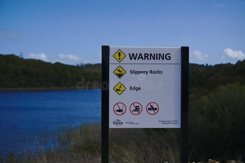 Slippery Rocks Warning stock photo