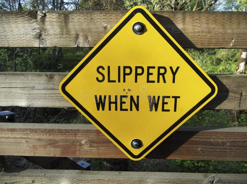 Slippery When Wet Sign. And warning stock photos