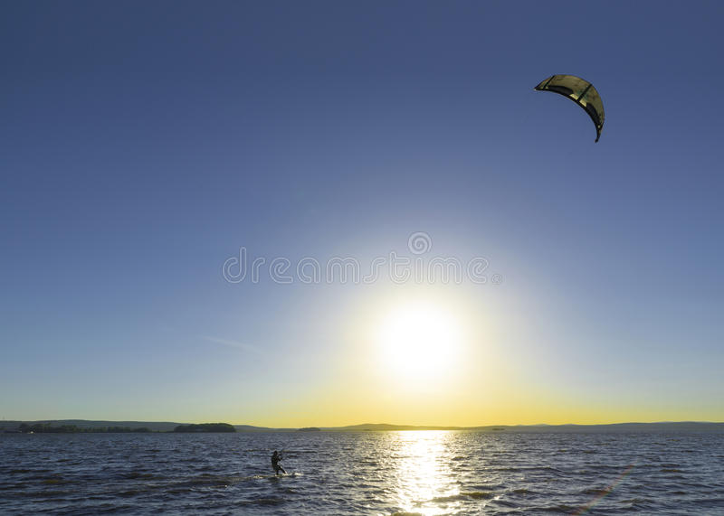Slipping through the waves with a parachute stock image