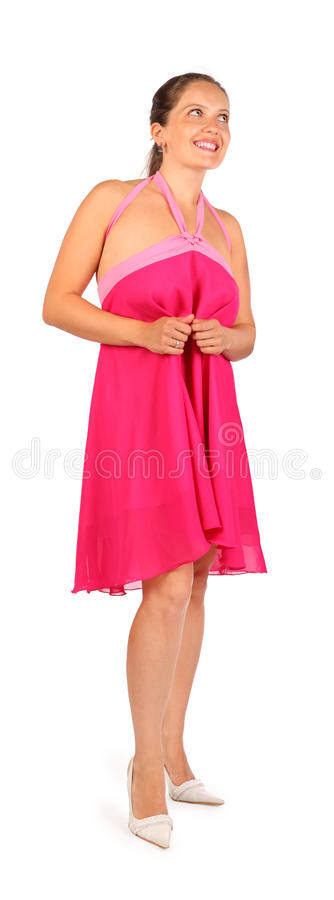 Slitage klänningleenden för härlig kvinna i studio royaltyfri foto