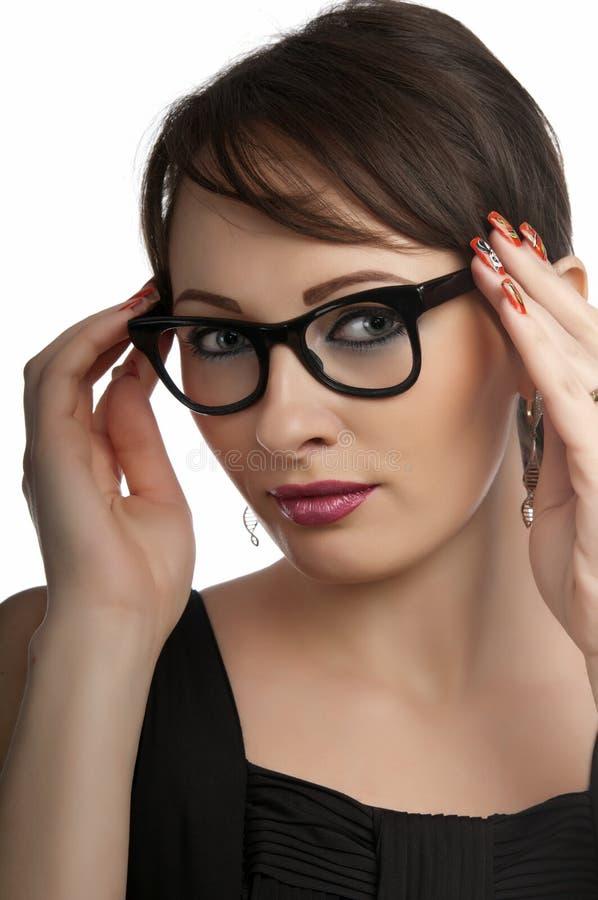slitage kvinna för affärsexponeringsglasstående royaltyfria bilder