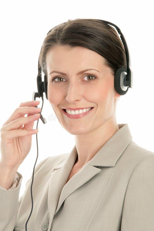 slitage kvinna för hörlurar med mikrofon royaltyfri bild