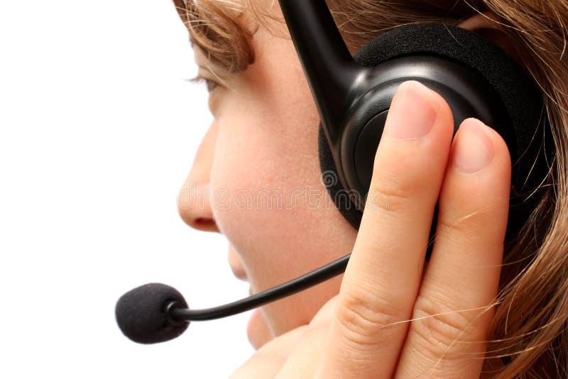 slitage kvinna för hörlurar med mikrofon royaltyfria foton