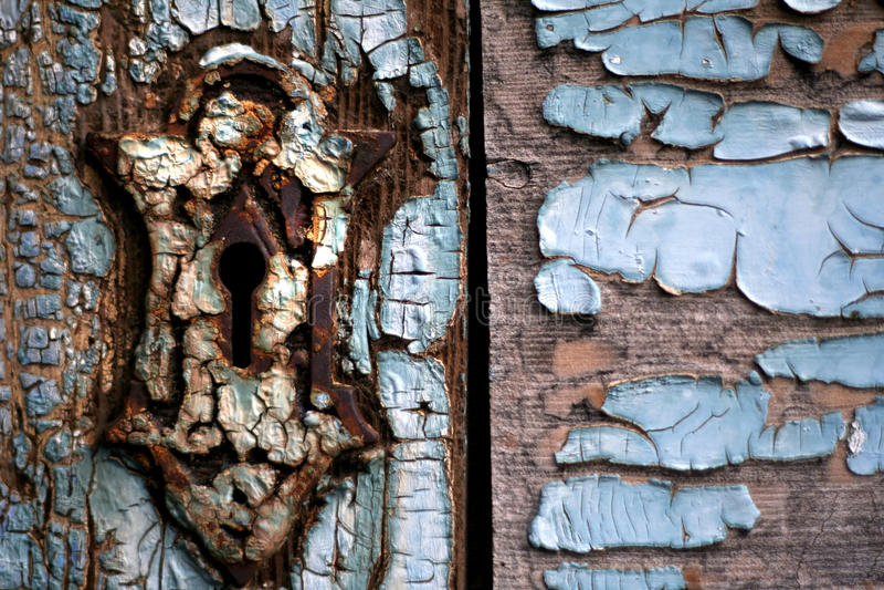 slitage trä för dörrkeyhole ut royaltyfri fotografi