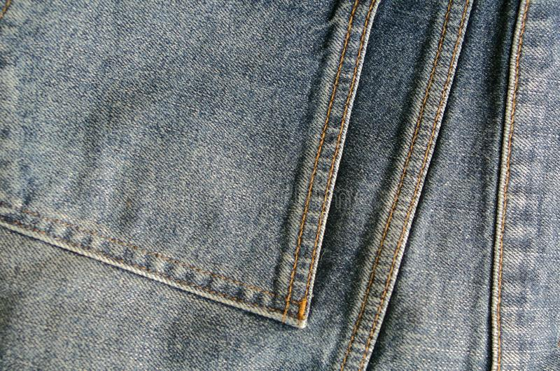 Slitet ljus - jeanstyg med facket royaltyfri fotografi