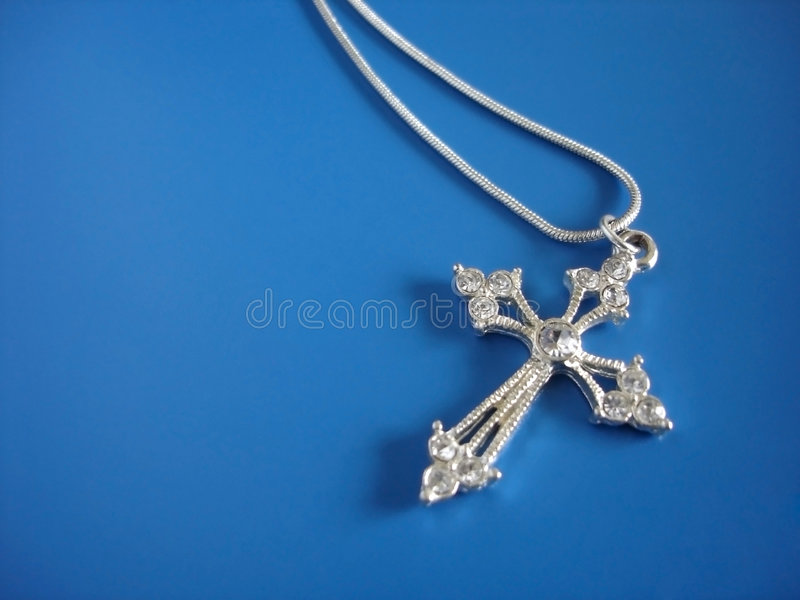 Sliver Cross and Chain. Sliver Jewelled Cross and Chain on Blue stock images