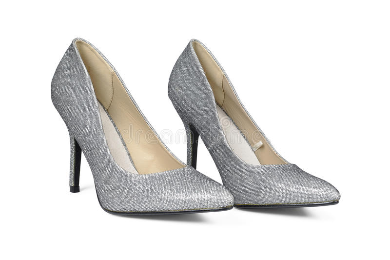 Sliver high hell shoes. A pair of sliver high hell shoes isolated on white with clipping path royalty free stock photography