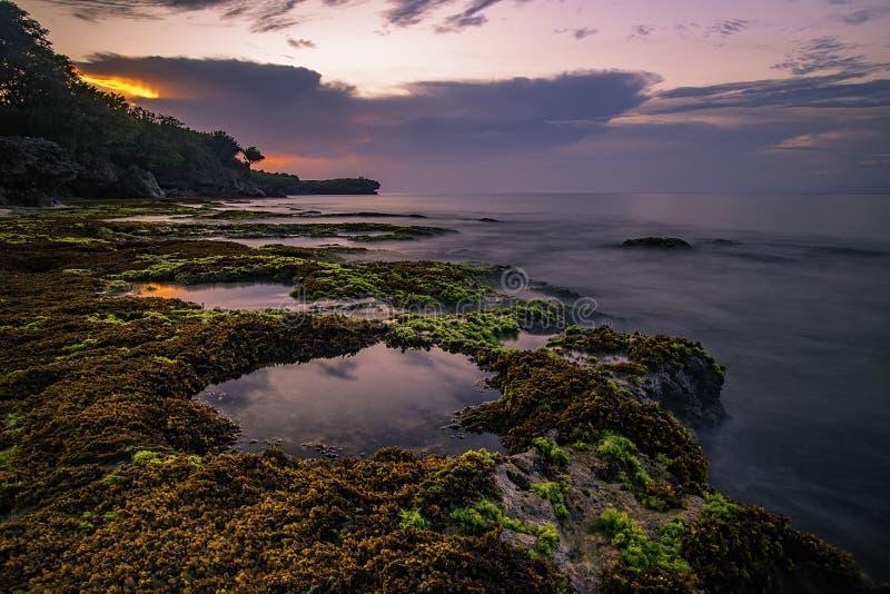 A sliver of light at sunset. Tunggak Sabo Beach, Jimbaran, Badung Selatan - Bali royalty free stock photos