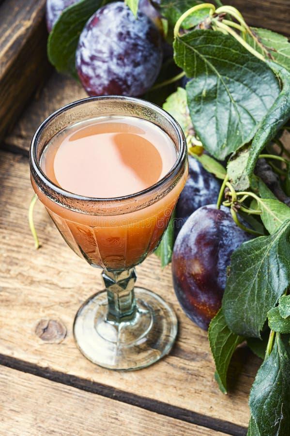 Romanian national plum liquor. Slivovitsa-plum brandy.Slivyanka,strong alcoholic drink made from ripe plums royalty free stock photo