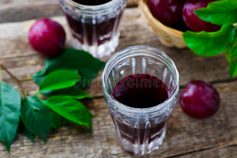 Slivovitz. alcoholic drink from plum. Style rustic. selective focus royalty free stock image