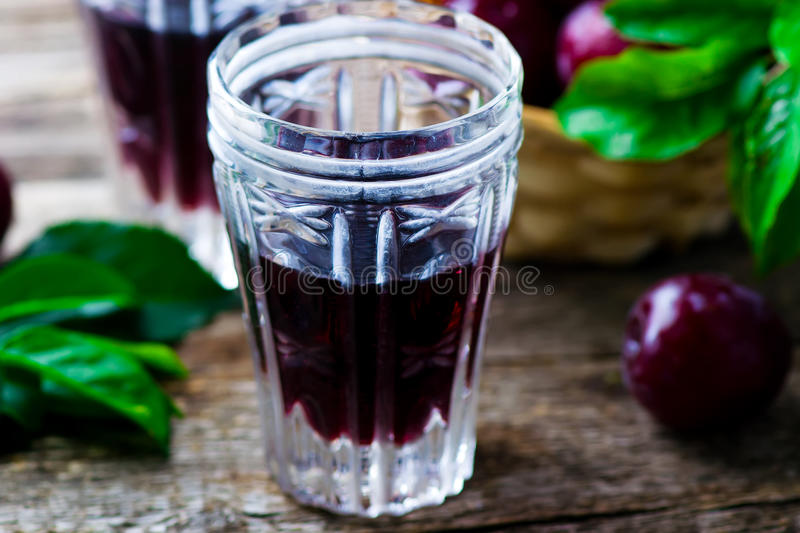 Slivovitz. alcoholic drink from plum. Style rustic. selective focus royalty free stock photography