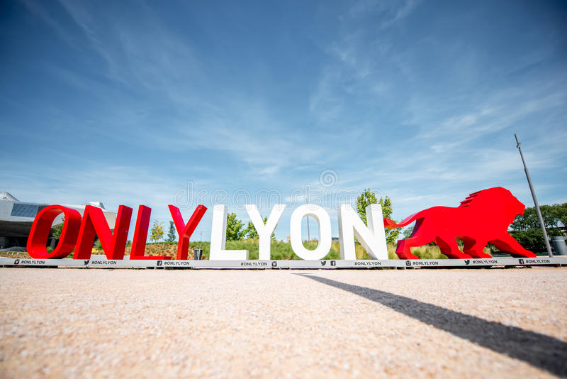 Slogan of Lyon city. LYON, FRANCE - May 21, 2017: Letters with figure of a lion near the new museum of confluences in Lyon city royalty free stock photo
