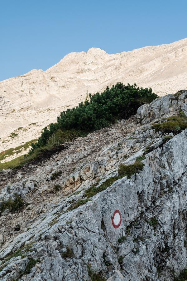 Slope in Alps with red and white marking on mountain trail. Slope in Julian Alps in Slovenia with red and white marking on mountain trail royalty free stock photos
