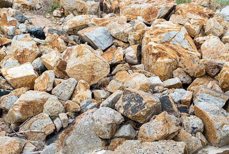 Slope of large uneven beige gray stones a lot of cobblestones part of the wild deserted place background promgulka in the mountain stock photography