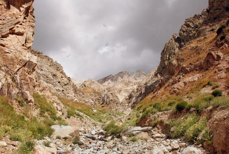 The slope of the mountains of Western Tien Shan in Uzbekistan stock photo