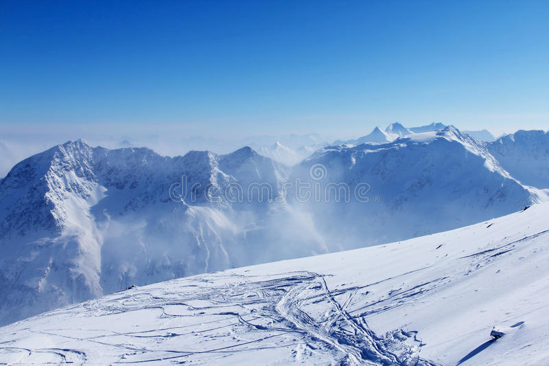 Slope with ski traces stock photo