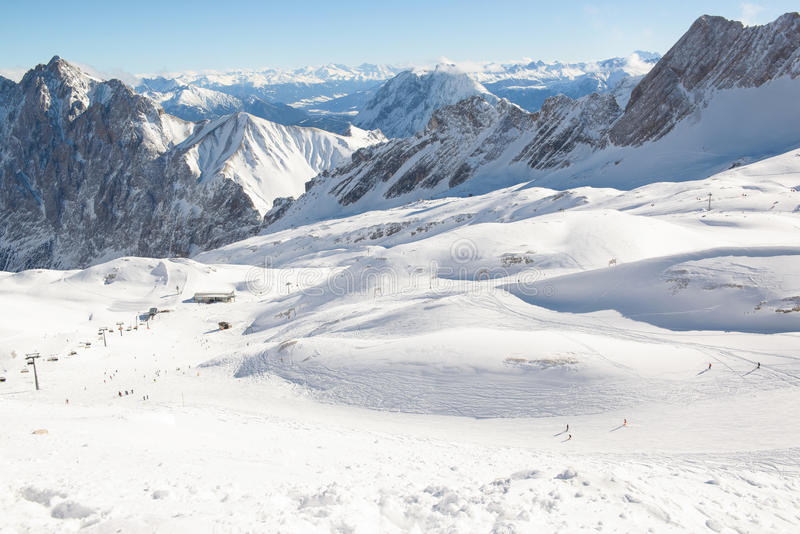 Slope on the skiing resort Zugspitze. Germany. Austria. Sunny day in the winter mountains stock photography