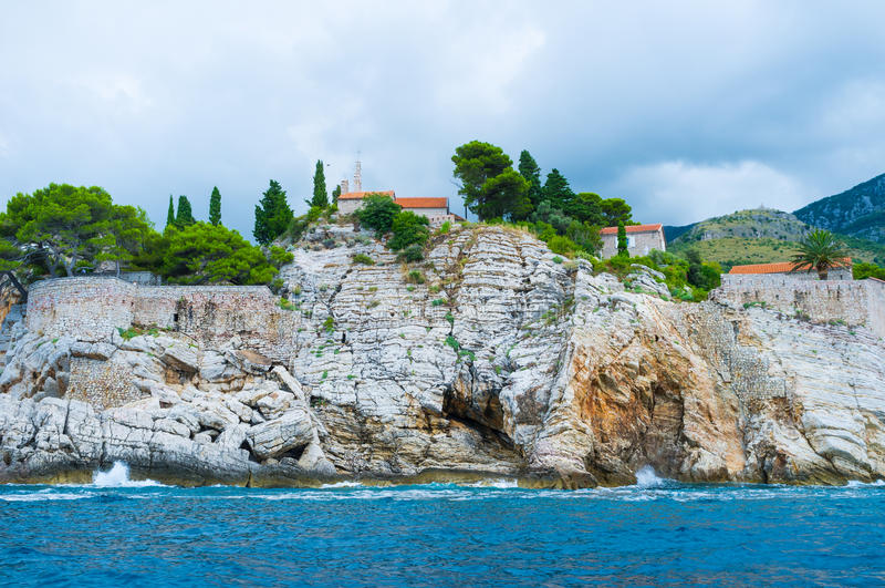 The slopes of Sveti Stefan royalty free stock image