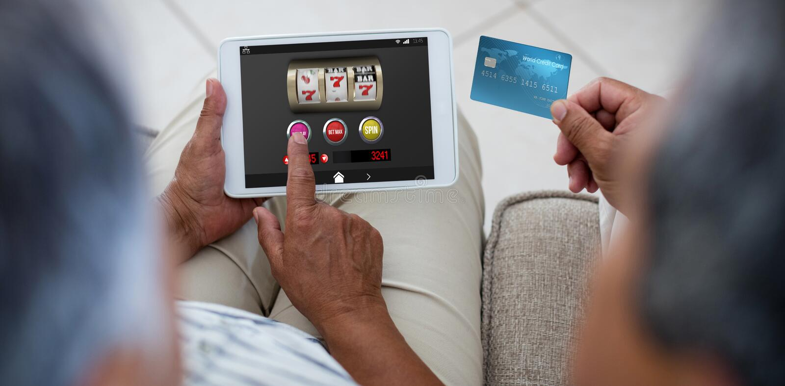 Composite image of slot machine with icons on mobile display. Slot machine with icons on mobile display against senior couple doing online shopping on digital stock image