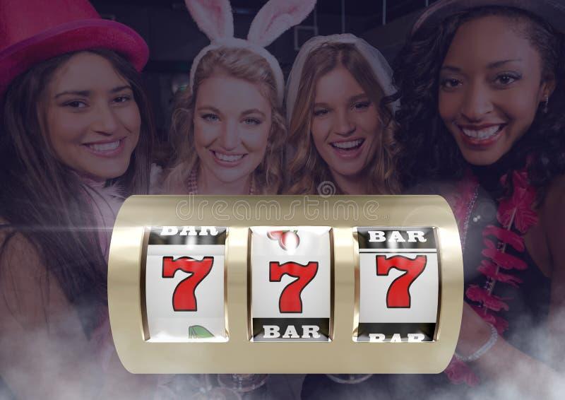 Slot machine na frente das mulheres do divertimento foto de stock royalty free