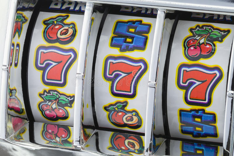 Slot Machine Sevens. Winning Jackpot with Slot Mahine on Lucky Sevens stock photo