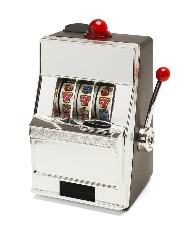 Slot Machine. Small Slot Machine with Sevens Jackpot Isolated on White Background royalty free stock photo