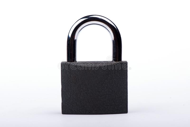 Slot op een witte achtergrond Kasteelclose-up Bescherming van bezit Veiligheid van geld stock fotografie
