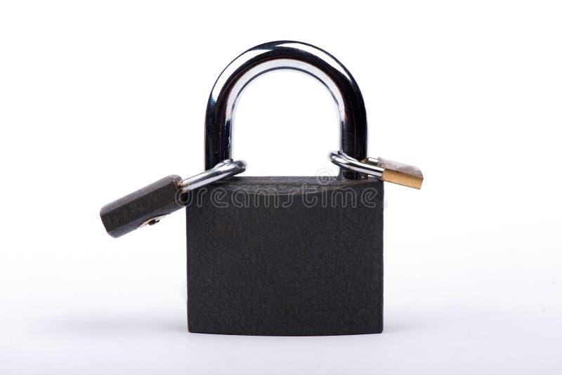 Slot op een witte achtergrond Kasteelclose-up Bescherming van bezit Veiligheid van geld royalty-vrije stock afbeeldingen