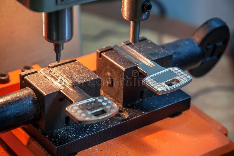 Slotenmaker dubbele machine stock foto