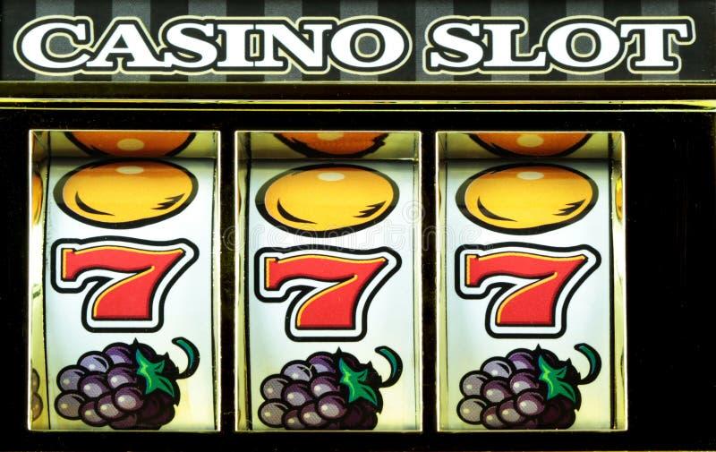 Slots. Casino slots three sevens close up royalty free stock images