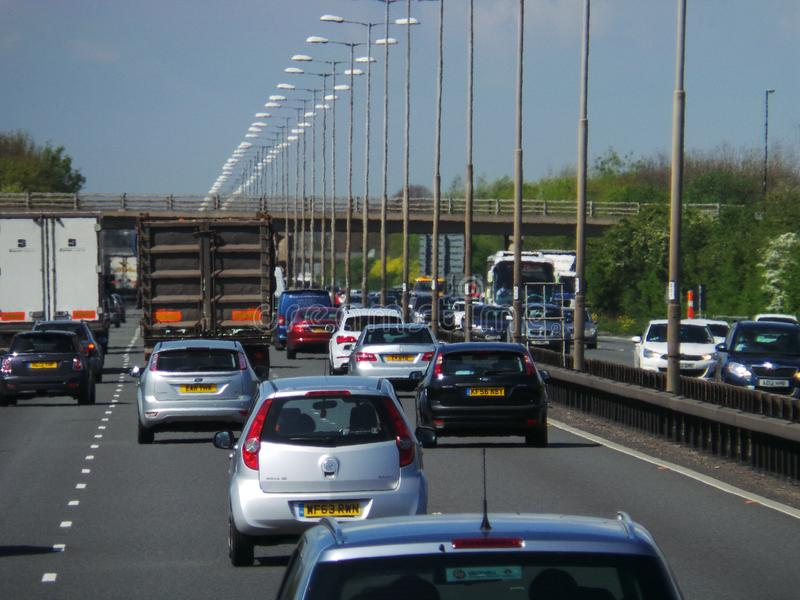 Motorway Traffic Jam. Slough, United Kingdom - April 11 2014: Traffic backed up along the M4 near Slough on a hot day with heat haze rising from the tarmac stock photo