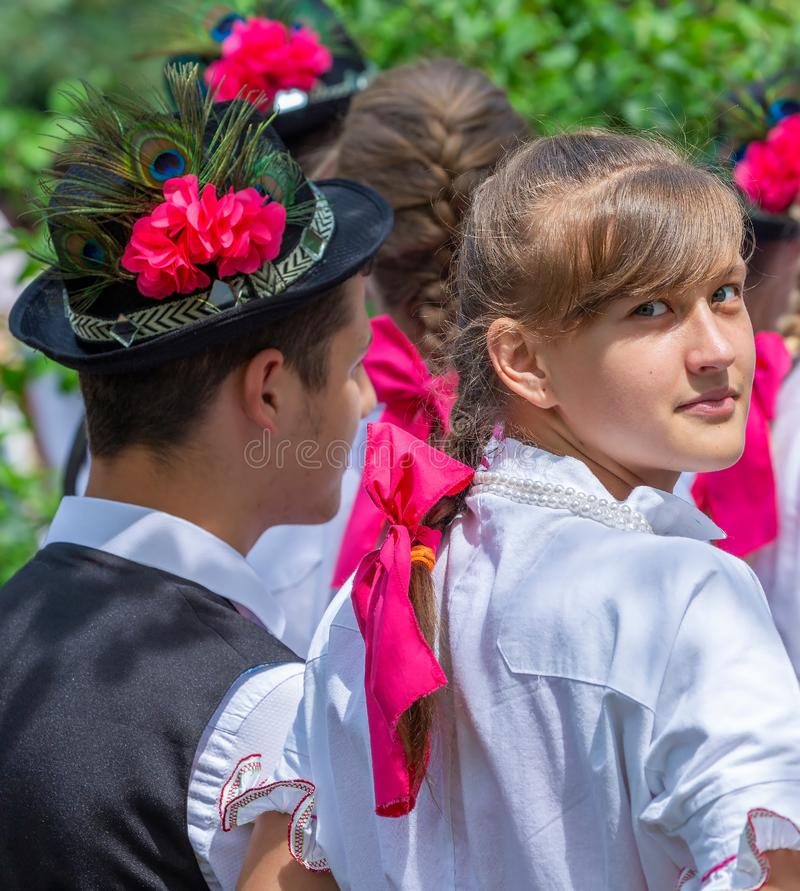 Slovak dancers in traditional costume. ROMANIA, TIMISOARA - JUNE 10, 2018: Young Slovak dancers in traditional costume present at Festival of ethnic groups stock images