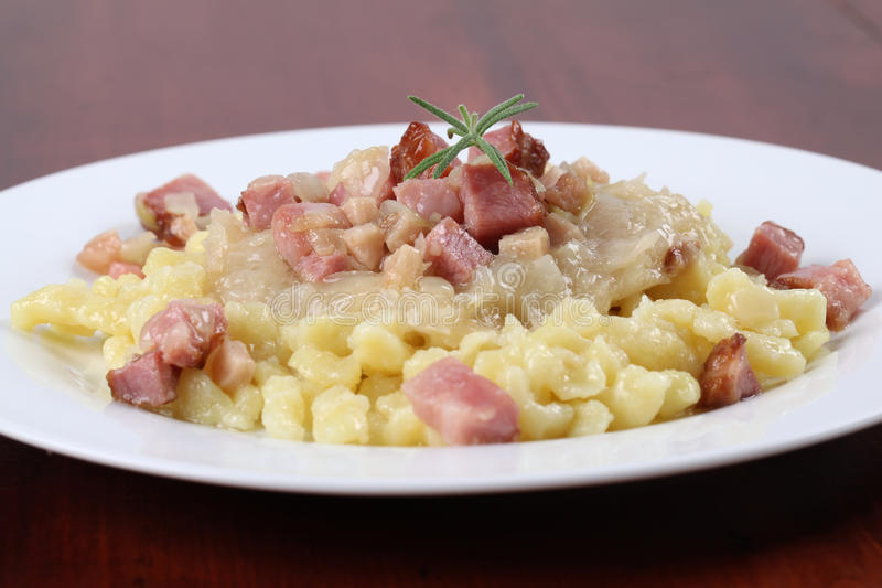 Slovak national food - Halushky. Slovak national food called halusky - small potato dumplings (gnocchi) with sauerkraut and smoked meat stock photography