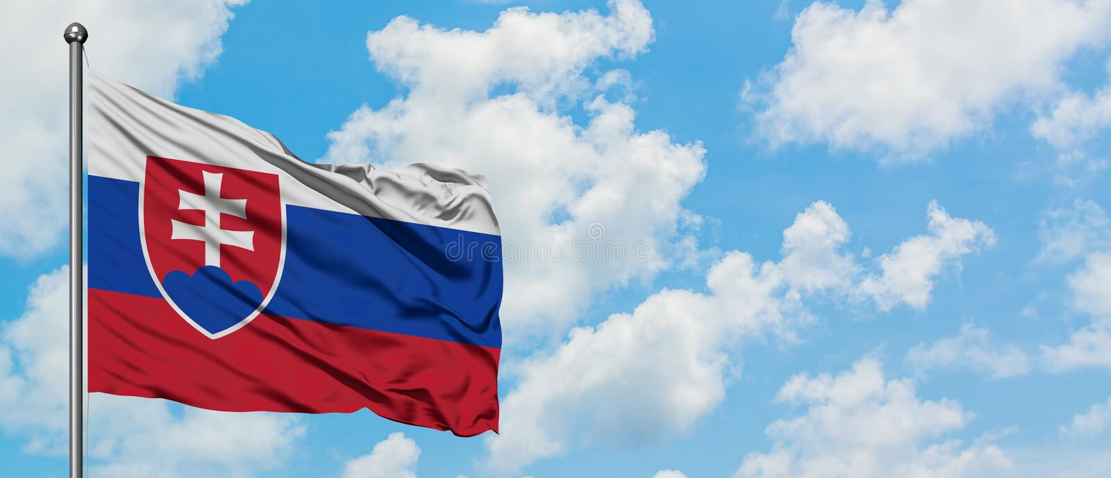 Slovakia flag waving in the wind against white cloudy blue sky. Diplomacy concept, international relations.  royalty free stock photography