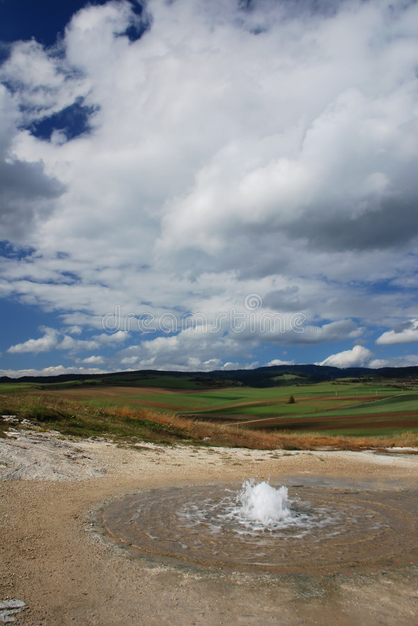 Slovakia geyser. Geyser in the landscape with clouds in the backgro stock photography