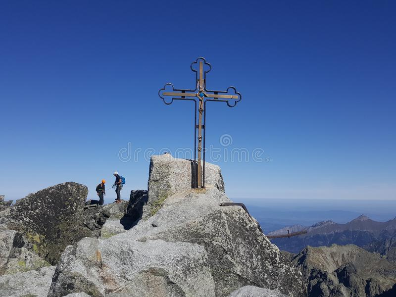 Slovakia, Tatra mountains - the cross on the Gerlach pick. Slovakia, Tatra mountains - the view of the cross on the Gerlach pick stock photos